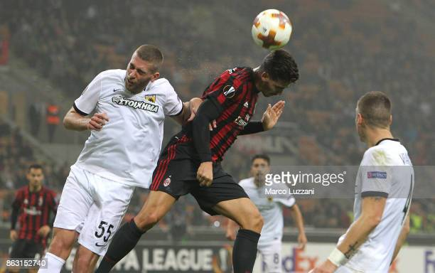 Andre Silva of AC Milan competes for the ball with Adam Tzanetopoulos of AEK Athens during the UEFA Europa League group D match between AC Milan and...