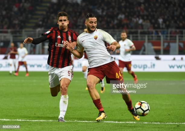 Andre Silva of AC Milan competes for the ball with Kostas Manolas of AS Roma during the Seria A 2017/18 match between AC Milan and AS Roma at Stadio...