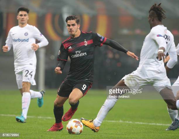 Andre Silva of AC Milan is challenged by Abdul Kadiri Mohammed of FK Austria Wien during the UEFA Europa League group D match between AC Milan and...