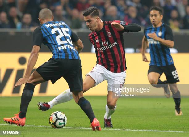 Andre Silva of AC Milan is challenged by Joao Miranda de Souza Filho of FC Internazionale Milano during the Serie A match between FC Internazionale...