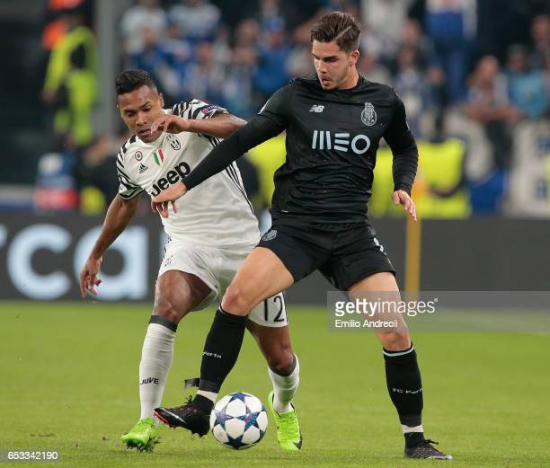 Andre Silva of FC Porto competes for the ball with Alex Sandro of Juventus FC during the UEFA Champions League Round of 16 second leg match between...