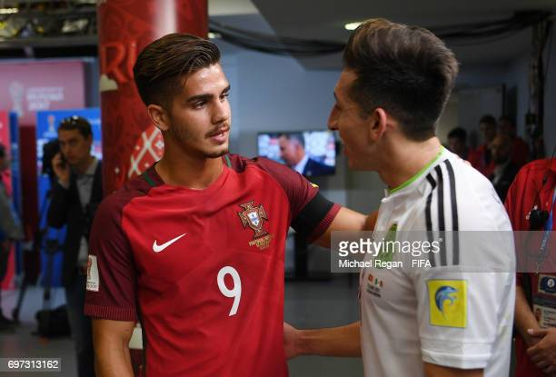 Andre Silva of Portugal and Hector Herrera of Mexico embrace in the tunnel after the FIFA Confederations Cup Russia 2017 Group A match between...