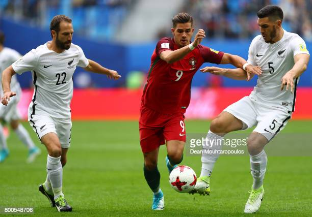 Andre Silva of Portugal and Michael Boxall of New Zealand battle for possession during the FIFA Confederations Cup Russia 2017 Group A match between...