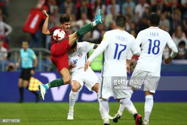 Andre Silva of Portugal and Pablo Hernandez of Chile battle for possession during the FIFA Confederations Cup Russia 2017 SemiFinal between Portugal...
