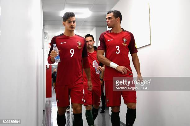 Andre Silva of Portugal and Pepe of Portugal speak as they walk out for the second half during the FIFA Confederations Cup Russia 2017 PlayOff for...