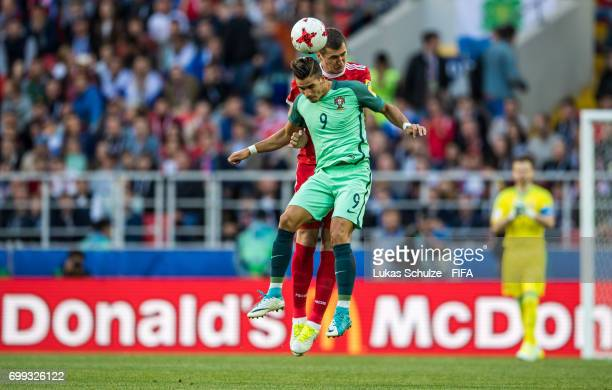 Andre Silva of Portugal and Viktor Vasin of Russia head the ball during the FIFA Confederations Cup Russia 2017 Group A match between Russia and...