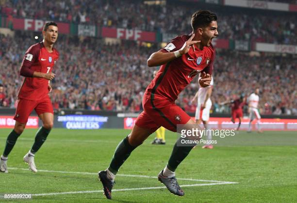Andre Silva of Portugal celebrates after scores the second goal against Switzerland during the FIFA 2018 World Cup Qualifier between Portugal and...
