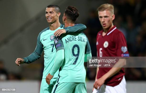 Andre Silva of Portugal celebrates his goal with Christiano Ronaldo during the FIFA 2018 World Cup Qualifier between Latvia and Portugal at Skonto...