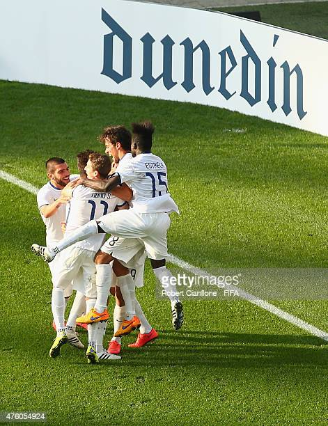 Andre Silva of Portugal celebrates with team mates after scoring a goal during the FIFA U20 World Cup New Zealand 2015 Group C match between Colombia...