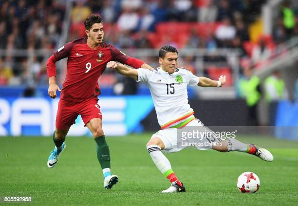 Andre Silva of Portugal fouls Hector Moreno of Mexico during the FIFA Confederations Cup Russia 2017 PlayOff for Third Place between Portugal and...