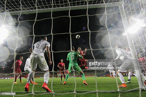 Andre Silva of Portugal heads on goal over the bar past goalkeeper Nikola Tzanev of New Zealand during the FIFA U20 World Cup New Zealand 2015 Round...
