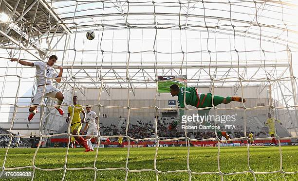 Andre Silva of Portugal heads the ball past Colombian goalkeeper Alvaro Montero to score during the FIFA U20 World Cup New Zealand 2015 Group C match...