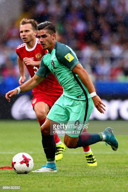 Andre Silva of Portugal runs past Viktor Vasin of Russia during the FIFA Confederations Cup Russia 2017 Group A match between Russia and Portugal at...