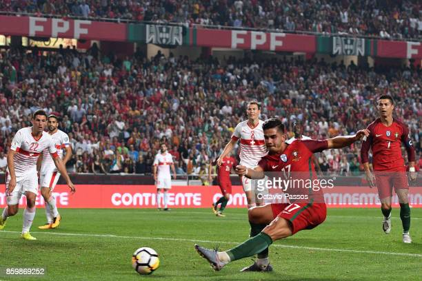 Andre Silva of Portugal shoots and scores the second goal against Switzerland during the FIFA 2018 World Cup Qualifier between Portugal and...