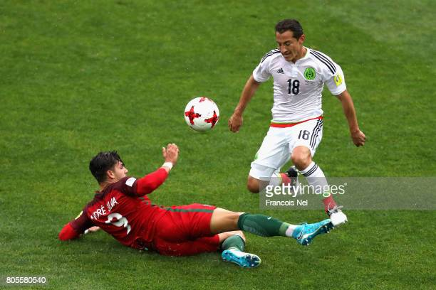 Andre Silva of Portugal tackles Andres Guardado of Mexico during the FIFA Confederations Cup Russia 2017 PlayOff for Third Place between Portugal and...