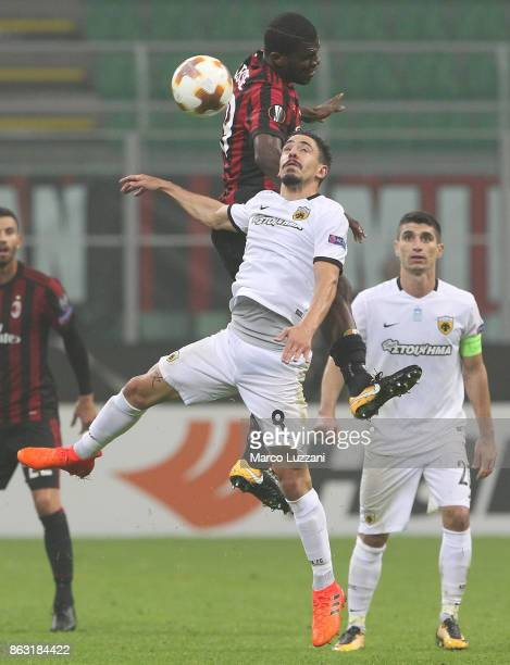 Andre Simoes of AEK Athens competes for the ball with Franck Kessie of AC Milan during the UEFA Europa League group D match between AC Milan and AEK...
