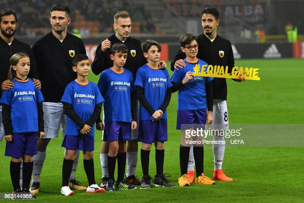 Andre Simoes of AEK Athens line up with banner #Equalgame during the UEFA Europa League group D match between AC Milan and AEK Athens on October 19...