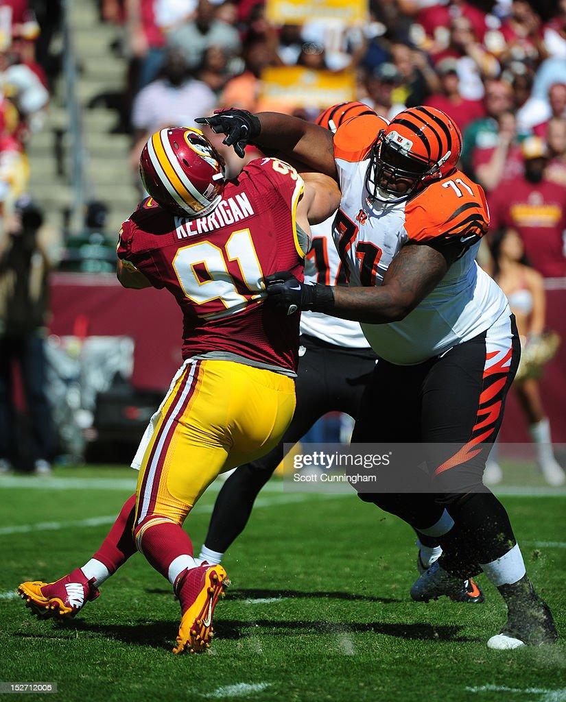 Andre Smith of the Cincinnati Bengals blocks against Ryan Kerrigan of the Washington Redskins at FedEx Field on September 23 2012 in Landover Maryland