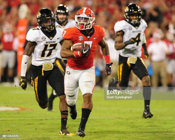 Andre Swift of the Georgia Bulldogs carries the ball for a 71 yard gain against the Missouri Tigers at Sanford Stadium on October 14 2017 in Athens...