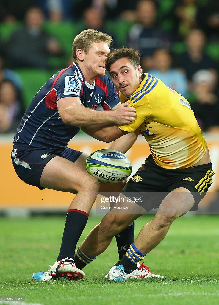 <a gi-track='captionPersonalityLinkClicked' href=/galleries/search?phrase=Andre+Taylor&family=editorial&specificpeople=2250666 ng-click='$event.stopPropagation()'>Andre Taylor</a> of the Hurricanes is tackled by Bryce Hegarty of the Rebels during the round 13 Super Rugby match between the Rebels and the Hurricanes at AAMI Park on May 9, 2014 in Melbourne, Australia.