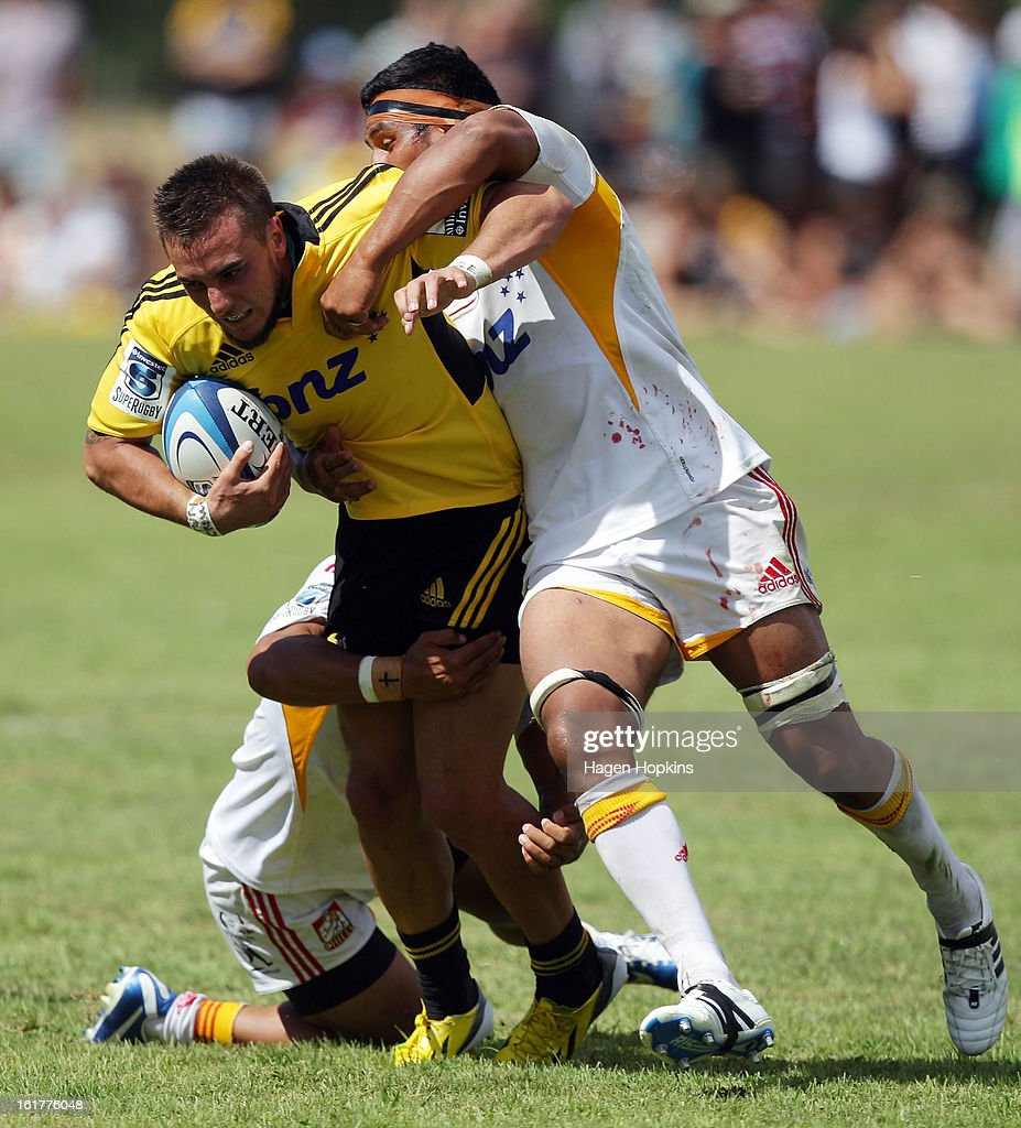 Andre Taylor of the Hurricanes is tackled during the Super Rugby trial match between the Hurricanes and the Chiefs at Mangatainoka RFC on February 16, 2013 in Mangatainoka, New Zealand.