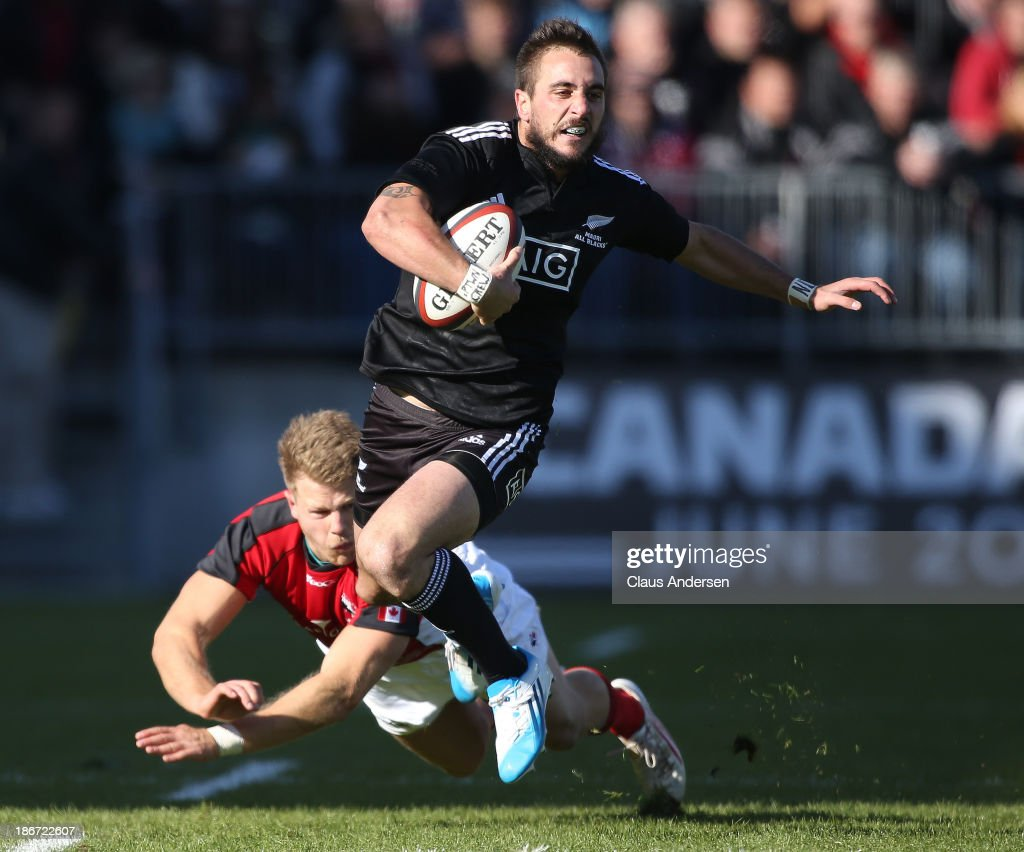 <a gi-track='captionPersonalityLinkClicked' href=/galleries/search?phrase=Andre+Taylor&family=editorial&specificpeople=2250666 ng-click='$event.stopPropagation()'>Andre Taylor</a> #14 of the New Zealand Maori All Blacks breaks a tackle against Team Canada during the AIG Canada friendly game at BMO Field on November 3, 2013 in Toronto, Ontario, Canada.