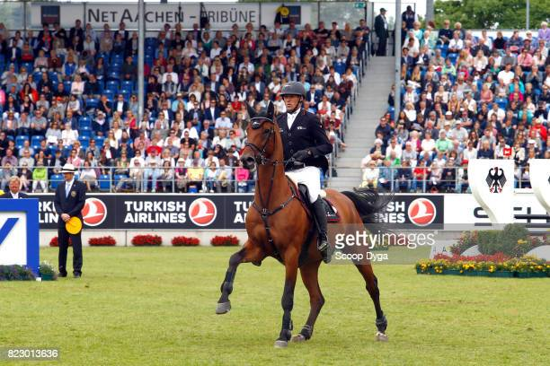 Andre THIEME riding ARETINO during the Rolex Grand Prix part of the Rolex Grand Slam of Show Jumping of the World Equestrian Festival on July 23 2017...