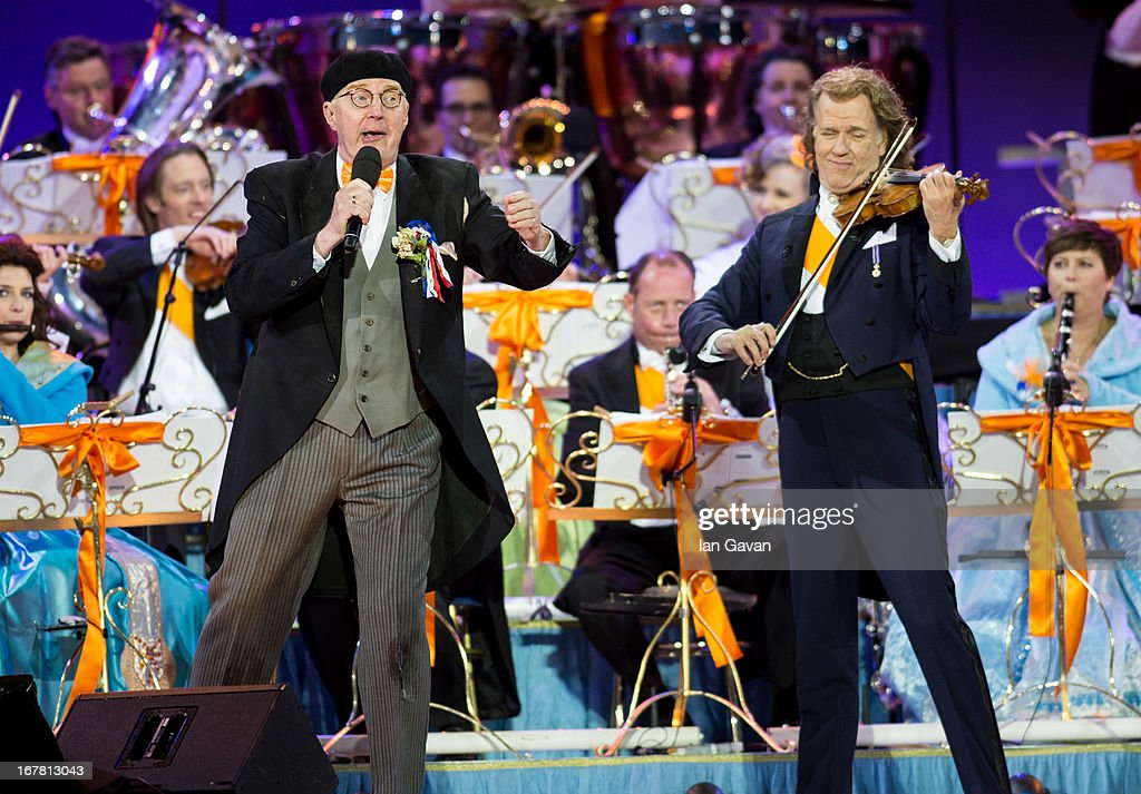 Andre van Duin and <a gi-track='captionPersonalityLinkClicked' href=/galleries/search?phrase=Andre+Rieu&family=editorial&specificpeople=1016048 ng-click='$event.stopPropagation()'>Andre Rieu</a> perform on stage at Museumplien during the inauguration of King Willem Alexander of the Netherlands as Queen Beatrix of the Netherlands abdicates on April 30, 2013 in Amsterdam, Netherlands.