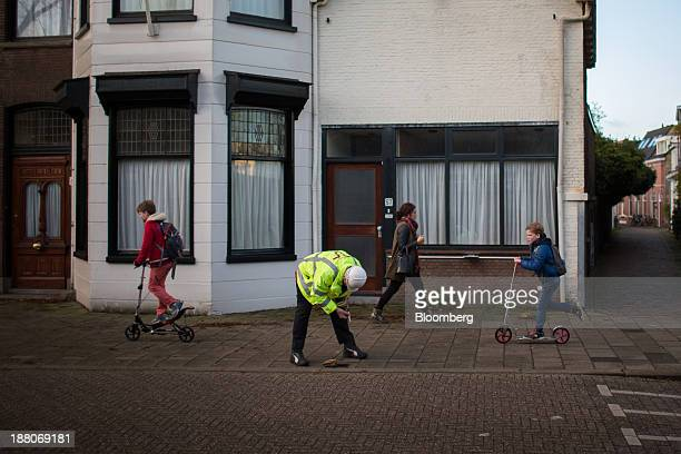 Andre van Krieken a 69yearold employed via specialist seniors recruitment company 65plus checks a tape measure as he records water levels on the...
