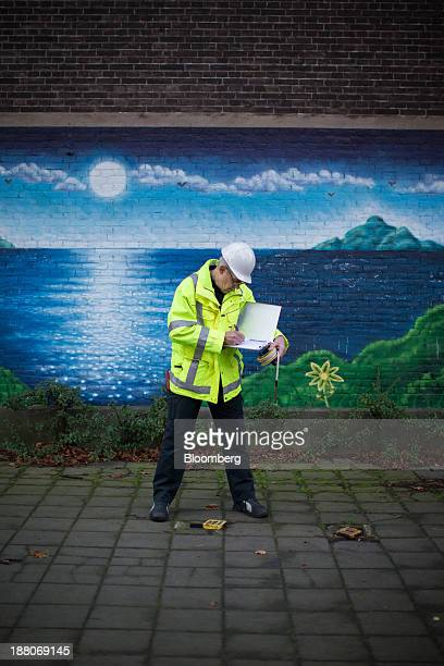 Andre van Krieken a 69yearold employed via specialist seniors recruitment company 65plus makes notes as he records water levels on the Spoorzone...
