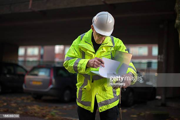 Andre van Krieken a 69yearold employed via specialist seniors recruitment company 65plus checks documents as he records water levels on the Spoorzone...