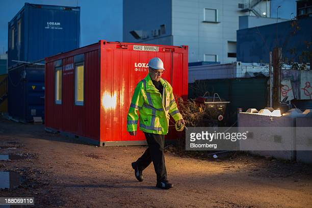 Andre van Krieken a 69yearold employed via specialist seniors recruitment company 65plus walks on a construction site of the Spoorzone Delft railway...