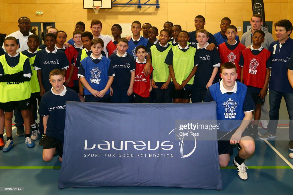 Andre Villas Boas poses with local school children after a coaching session during the Laureus Urban Research report launch on January 16, 2013 in London, England.