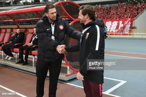 Andre VillasBoas head coach of Shanghai SIPG shakes hands with Tony Popovic head coach of Western Sydney Wanderers prior to the AFC Champions League...