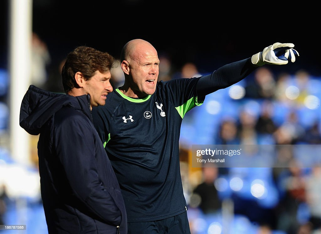 Andre Villas-Boas (L), manager, and Brad Friedel of Tottenham Hotspur during the Barclays Premier League match between Everton and Tottenham Hotspur at Goodison Park on November 3, 2013 in Liverpool, England.