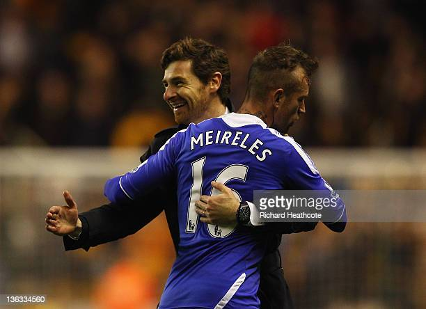 Andre VillasBoas manager of Chelsea celebrates victory with Raul Meireles after the Barclays Premier League match between Wolverhampton Wanderers and...