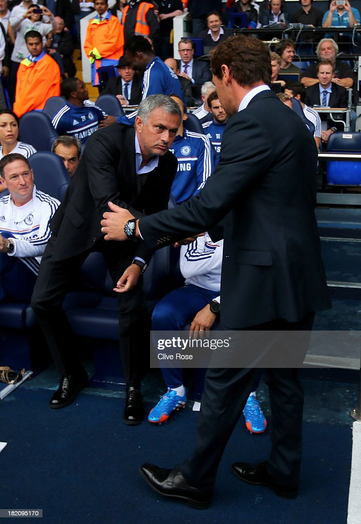 Andre Villas-Boas manager of Tottenham Hotspur (R) shakes hands with Jose Mourinho manager of Chelsea prior to the Barclays Premier League match between Tottenham Hotspur and Chelsea at White Hart Lane on September 28, 2013 in London, England.