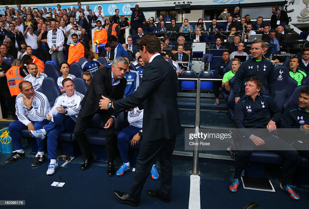 Andre Villas-Boas manager of Tottenham Hotspur (R) shakes hands with Jose Mourinho manager of Chelsea as the team benches look on prior to the Barclays Premier League match between Tottenham Hotspur and Chelsea at White Hart Lane on September 28, 2013 in London, England.