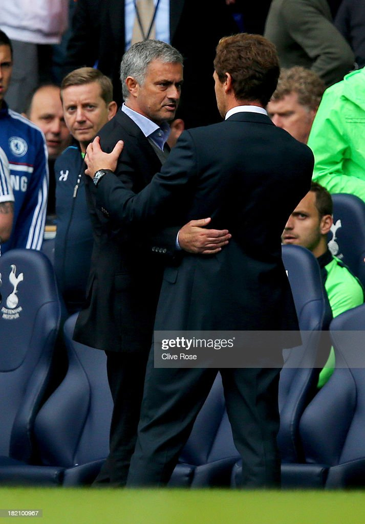 Andre Villas-Boas manager of Tottenham Hotspur (R) shakes hands with Jose Mourinho manager of Chelsea after the Barclays Premier League match between Tottenham Hotspur and Chelsea at White Hart Lane on September 28, 2013 in London, England.