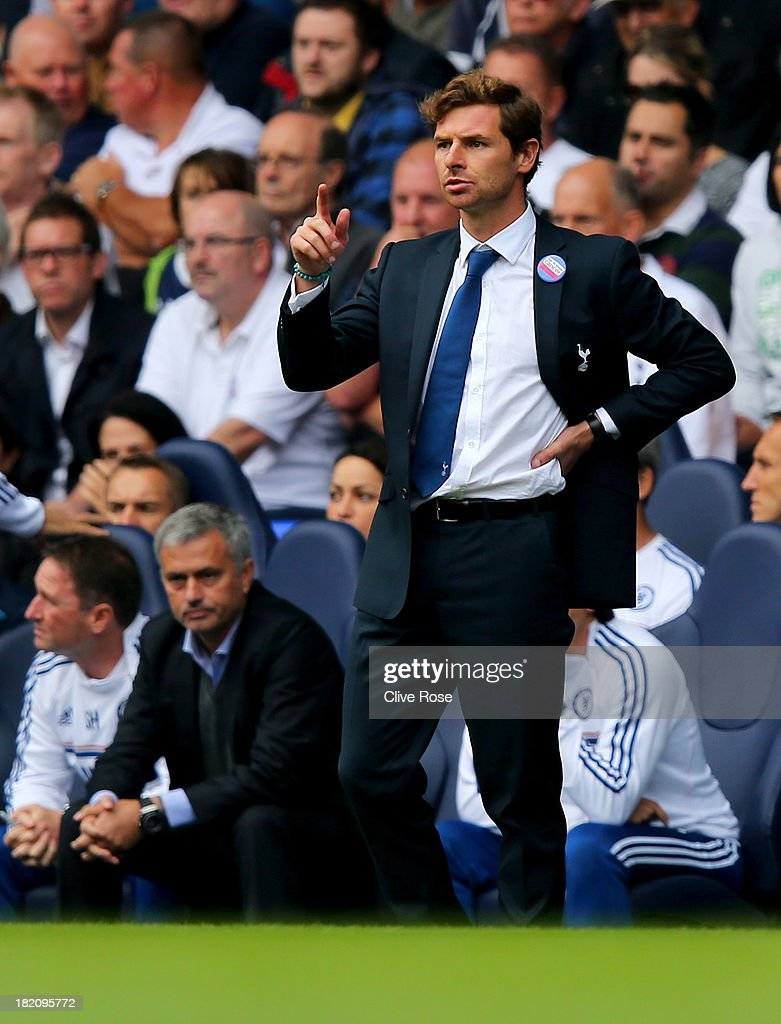 Andre Villas-Boas manager of Tottenham Hotspur (R) signals as Jose Mourinho manager of Chelsea (L) looks on during the Barclays Premier League match between Tottenham Hotspur and Chelsea at White Hart Lane on September 28, 2013 in London, England.