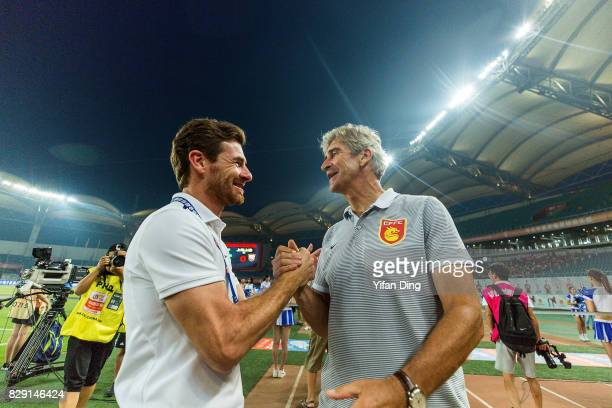 Andre VillasBoas of Shanghai SIPG and Manuel Pellegrini of Hebei China fortune greet piror to the China Super League match between Hebei China...