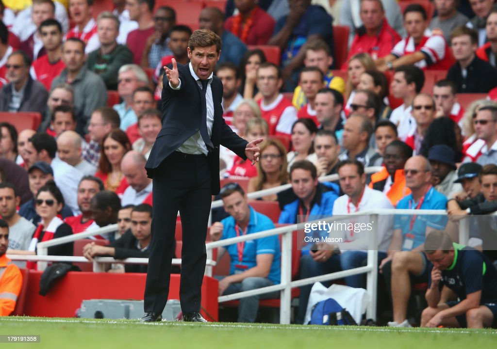 Andre Villas-Boas of Tottenham Hotspur gesticulates during the Barclays Premier League match between Arsenal and Tottenham Hotspur at Emirates Stadium on September 01, 2013 in London, England.