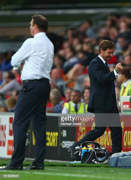 Andre VillasBoas the manager of Tottenham Hotspur clenches his fist after his side score a last minute winner as Malkay Mackay the manager of Cardiff...