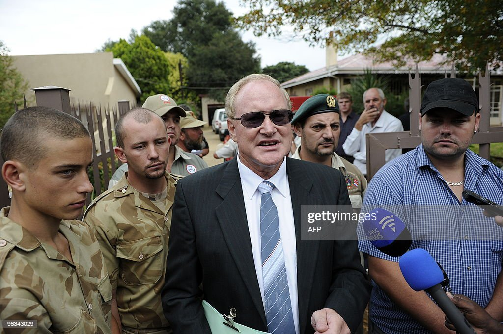 Andre Visagie, Secretary General of the Afrikaans Resistance Movement (AWB) talks to journalists in front of the AWB headquarters on April 9, 2010 in Ventersdorp ahead of the funeral of the AWB's leader Eugene Terre'Blanche. Heavily-armed South African police massed outside Eugene Terre'Blanche's funeral today as mourners paid last respects to a white supremacist whose murder has reopened racial wounds. Six days after the leader of the Afrikaner Resistance Movement (AWB) was hacked and bludgeoned to death at his farm in the sparse North West province, dozens of supporters of his neo-Nazi party gathered at the local church where Terre-Blanche was being laid to rest.