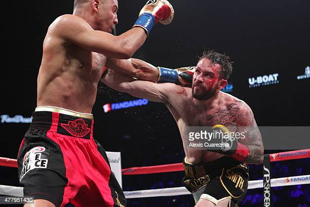 Andre Ward and Paul Smith exchange blows during their Cruiserweight fight at ORACLE Arena on June 20 2015 in Oakland California