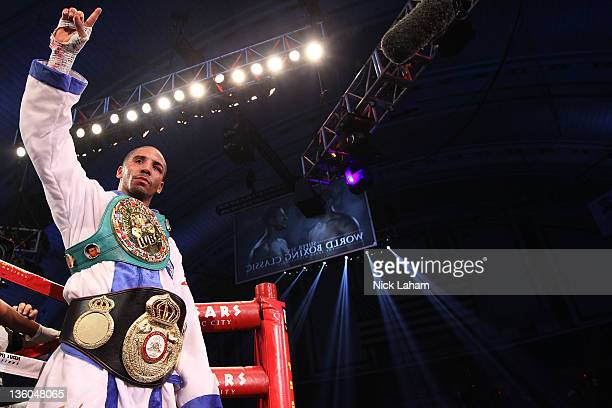 Andre Ward celebrates defeating Carl Froch of England during their WBA/WBC Super Middleweight Championship bout at Boardwalk Hall on December 17 2011...
