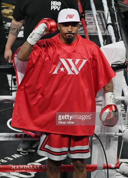 Andre Ward gestures to the crowd as he enters the ring for his light heavyweight championship bout against Sergey Kovalev at the Mandalay Bay Events...