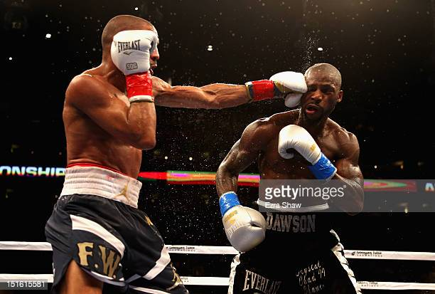 Andre Ward hits Chad Dawson in the 7th round of their WBA/WBC Super Middleweight championship fight at ORACLE Arena on September 8 2012 in Oakland...