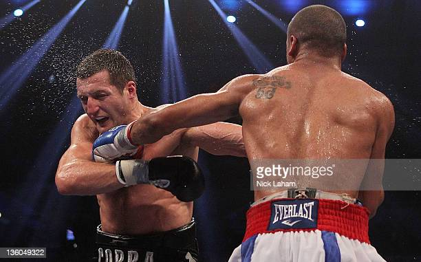 Andre Ward lands a left on Carl Froch of England during their WBA/WBC Super Middleweight Championship bout at Boardwalk Hall on December 17 2011 in...