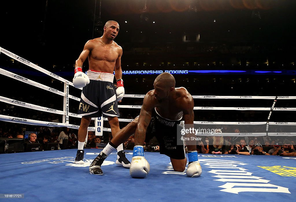 <a gi-track='captionPersonalityLinkClicked' href=/galleries/search?phrase=Andre+Ward&family=editorial&specificpeople=217398 ng-click='$event.stopPropagation()'>Andre Ward</a> (L) stands over <a gi-track='captionPersonalityLinkClicked' href=/galleries/search?phrase=Chad+Dawson&family=editorial&specificpeople=4026852 ng-click='$event.stopPropagation()'>Chad Dawson</a> after he knocked him down in the third round of their WBA/WBC Super Middleweight championship fight at ORACLE Arena on September 8, 2012 in Oakland, California. Ward won by TKO in the 10th round.